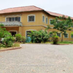 Executive House with 3 bedroom outhouse & large storage on 4 Acres of land to let or lease at Osu in Accra Ghana